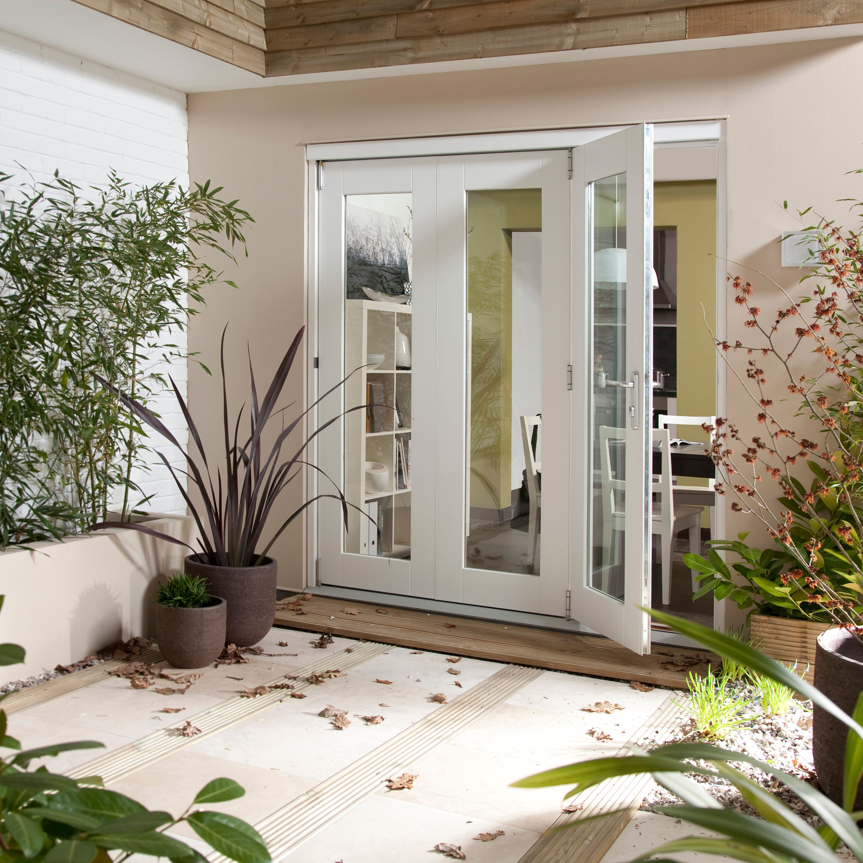 Pre-finished White Glazed Folding Sliding Patio Doors, (h)2105mm (w)1805mm