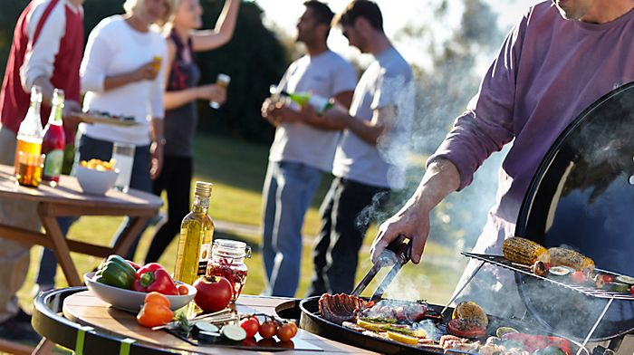 """man barbecuing at garden party"""