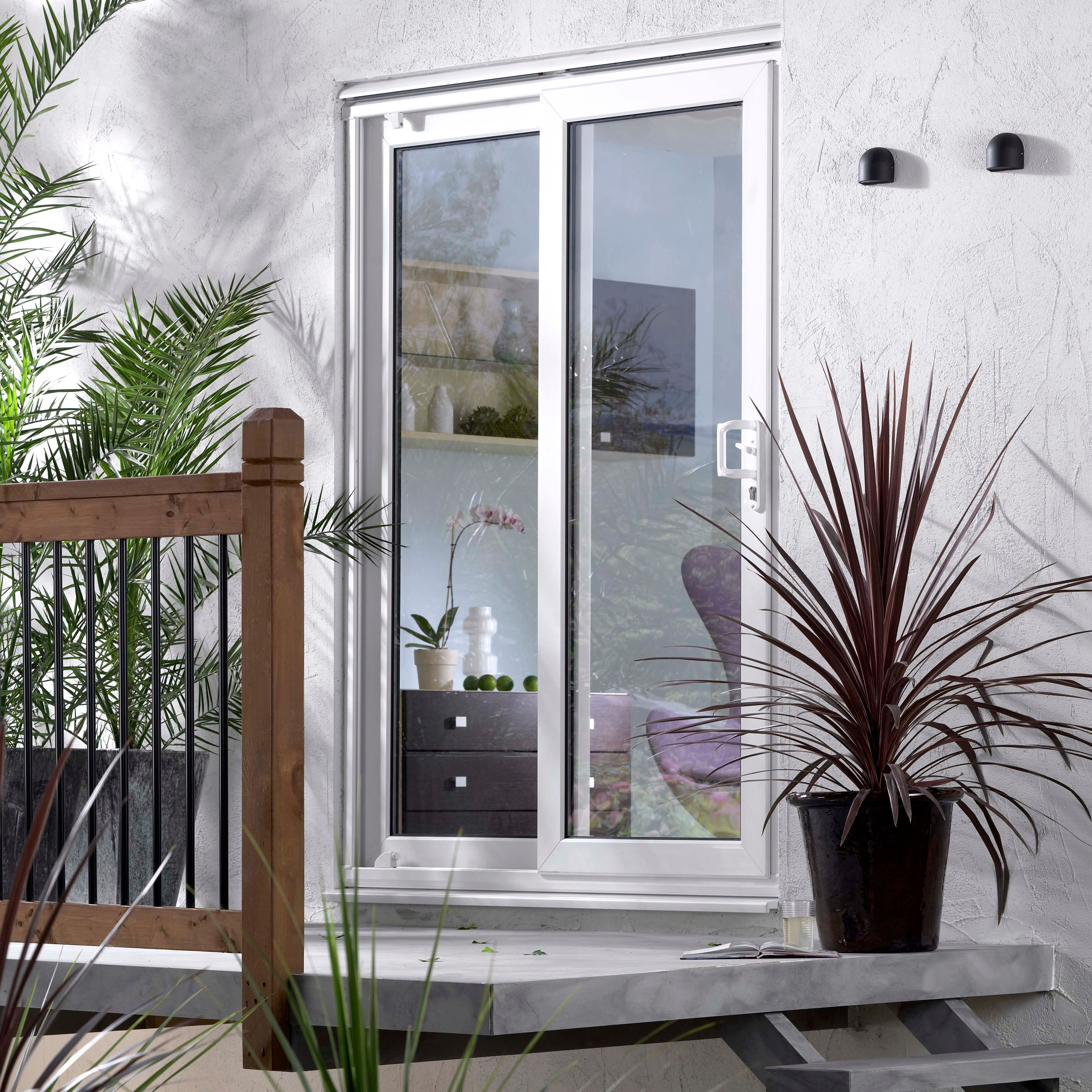 Pre finished white softwood glazed folding sliding patio for Pvcu patio doors