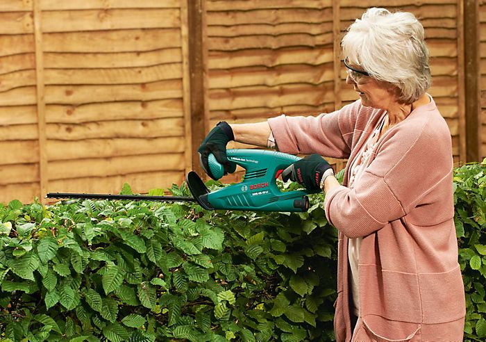 Lady cutting hedge