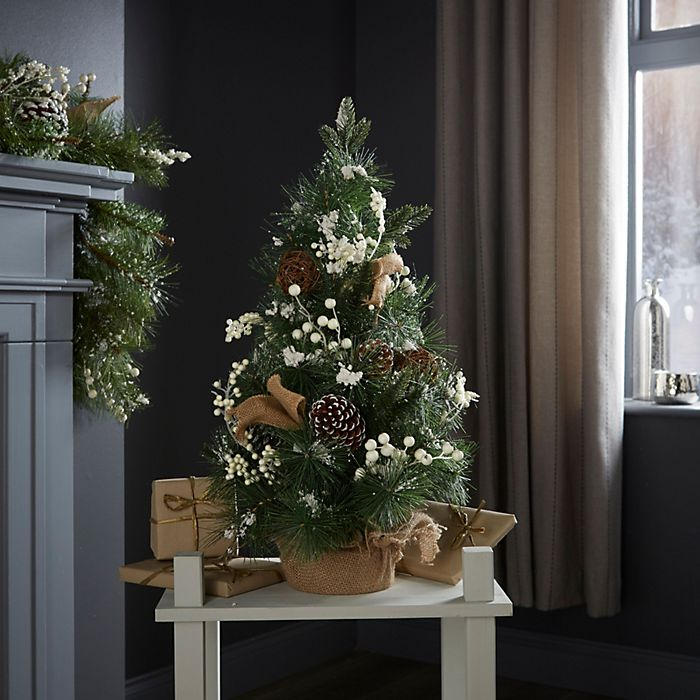 Natural foliage and hessian green table top Christmas tree