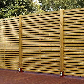 Contemporary Slatted Panel Fencing with fence post supports in garden
