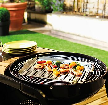 Food being cooked on a Blooma Barbecue Vegetable and Seafood Grill Basket