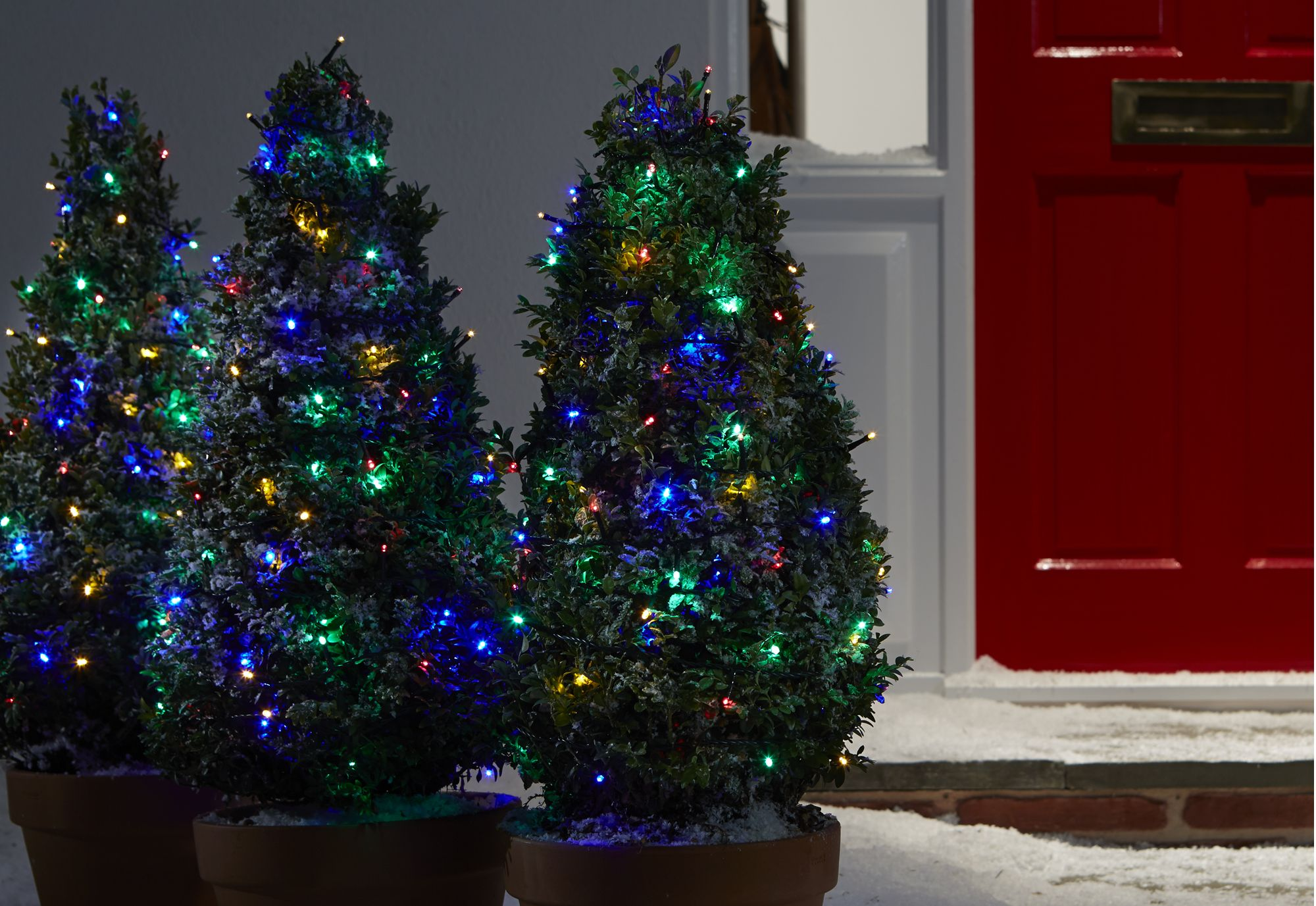 Do You String Christmas Tree Lights Top Bottom : How to hang outdoor Christmas lights Help & Ideas DIY at B&Q