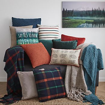 cushions & blankets and throws on a chair