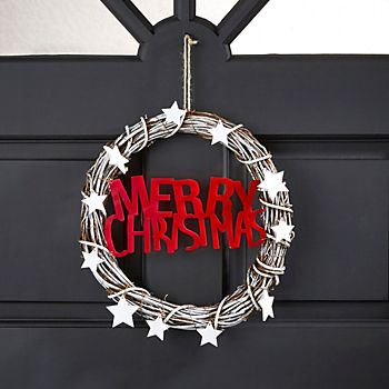 rattan merry christmas wreath on a door