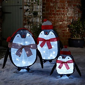 Penguin light silhouette family