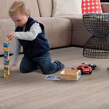 A child playing on Light Grey Toulon Oak Matt Waterproof Luxury Vinyl Click Flooring