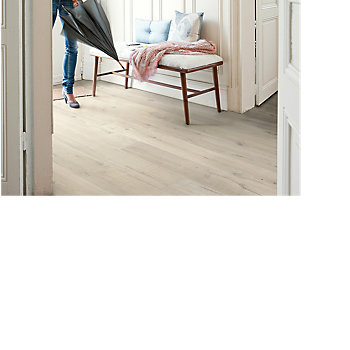 woman walking into a halway