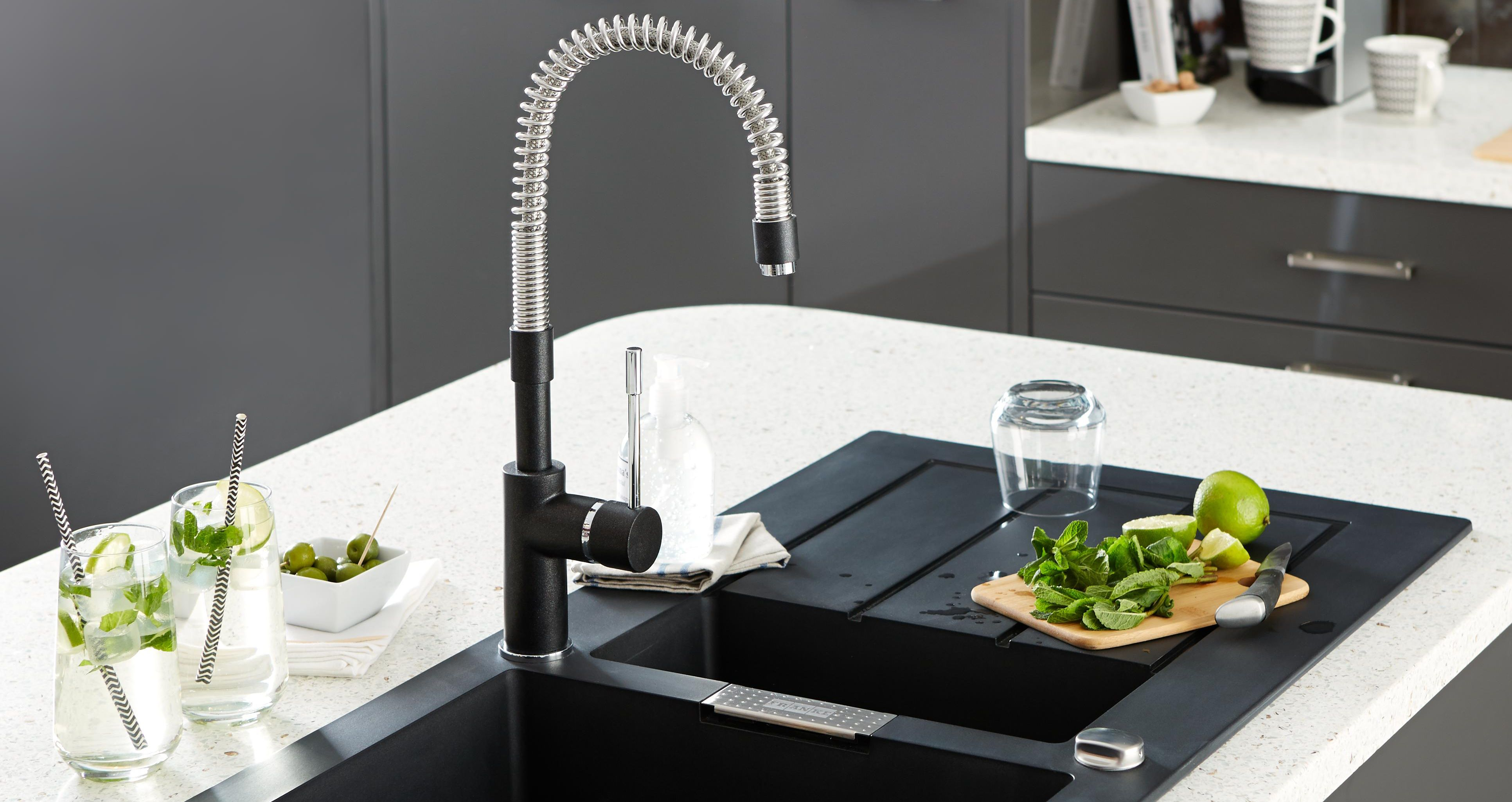 Black spring neck kitchen tap