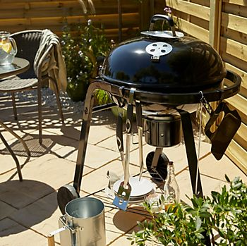 Barbecue with cooking utensils