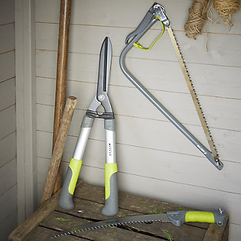 garden hand tools in a shed, on a bench and hung up