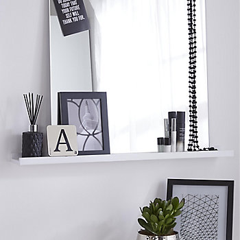 a dressing table made from a floating shelf