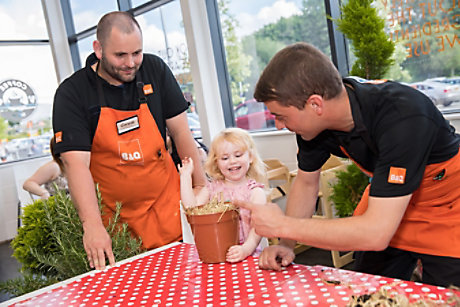 Children planting seeds in B&Q store