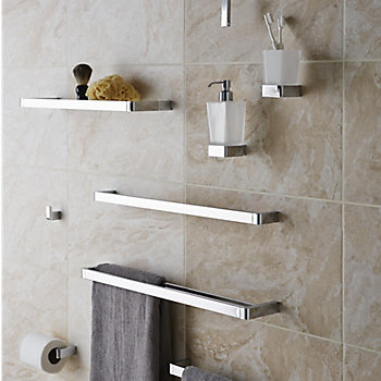 bathroom accessories clustered together on a wall