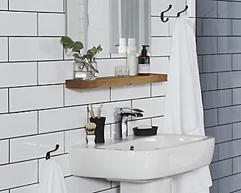 Bathroom with shelving above sink