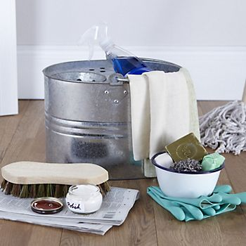 Cleaning products and bucket in kitchen