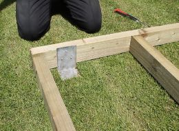Step 5 in laying a timber shed base
