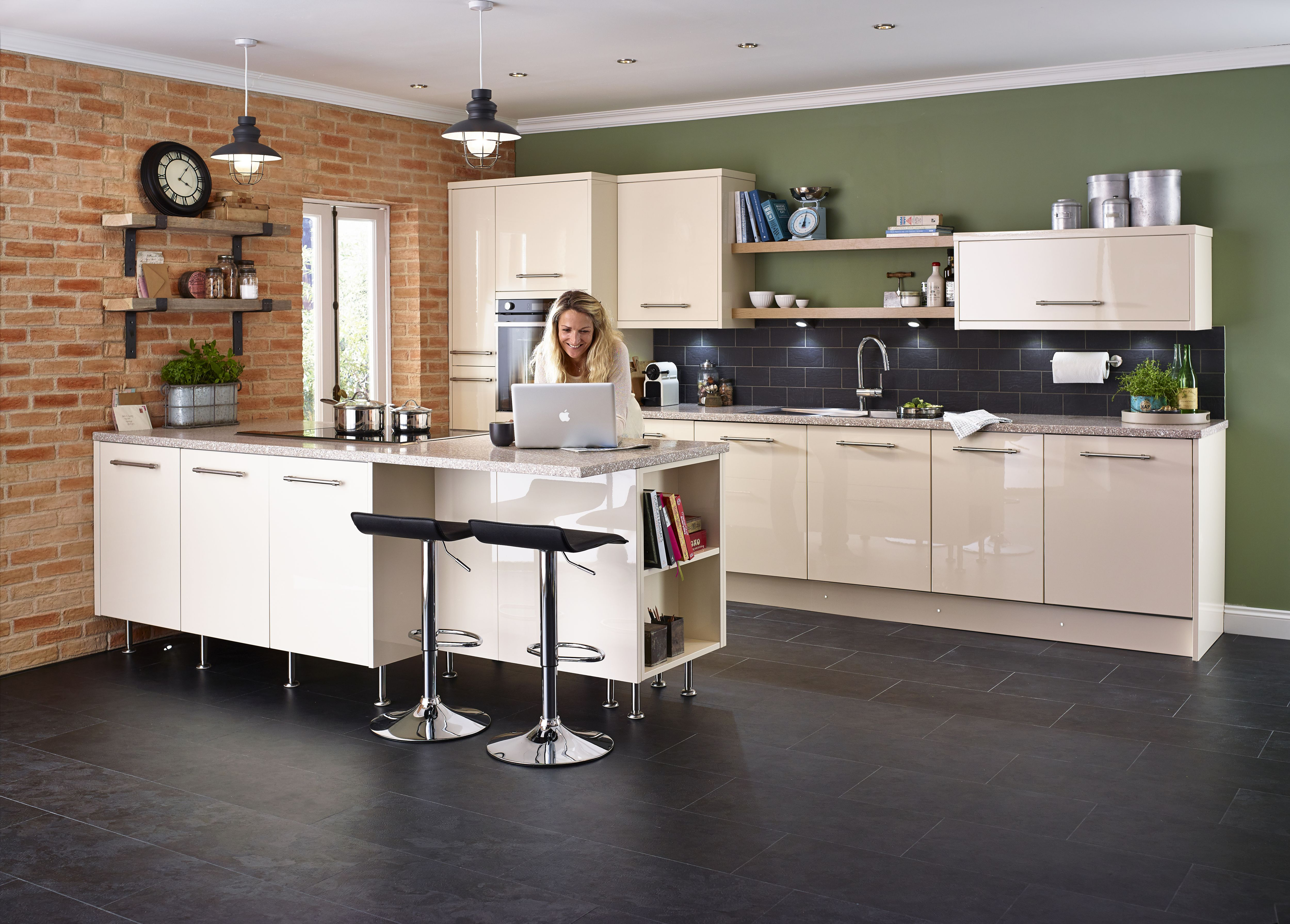 Woman On Laptop In Cooke U0026amp; Lewis Raffello High Gloss Cream Slab Fitted  Kitchen