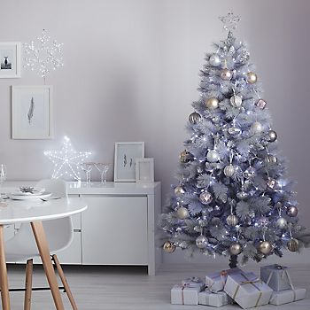 Flocked Artificial Christmas Tree decorated with Winter Wonderland decorations