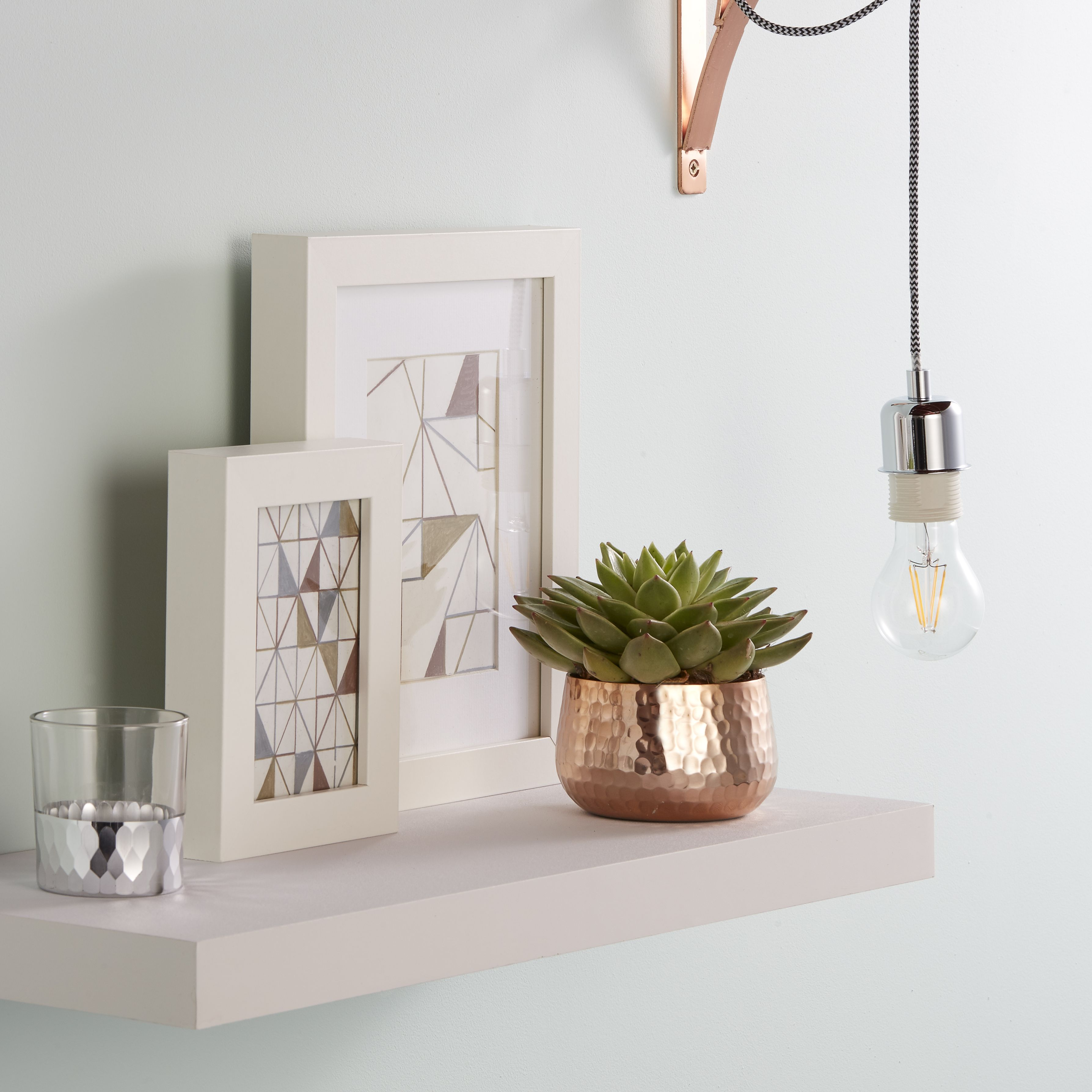white wall and floating shelf
