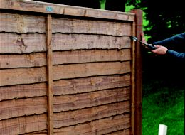 how to put up wood panels as a fence