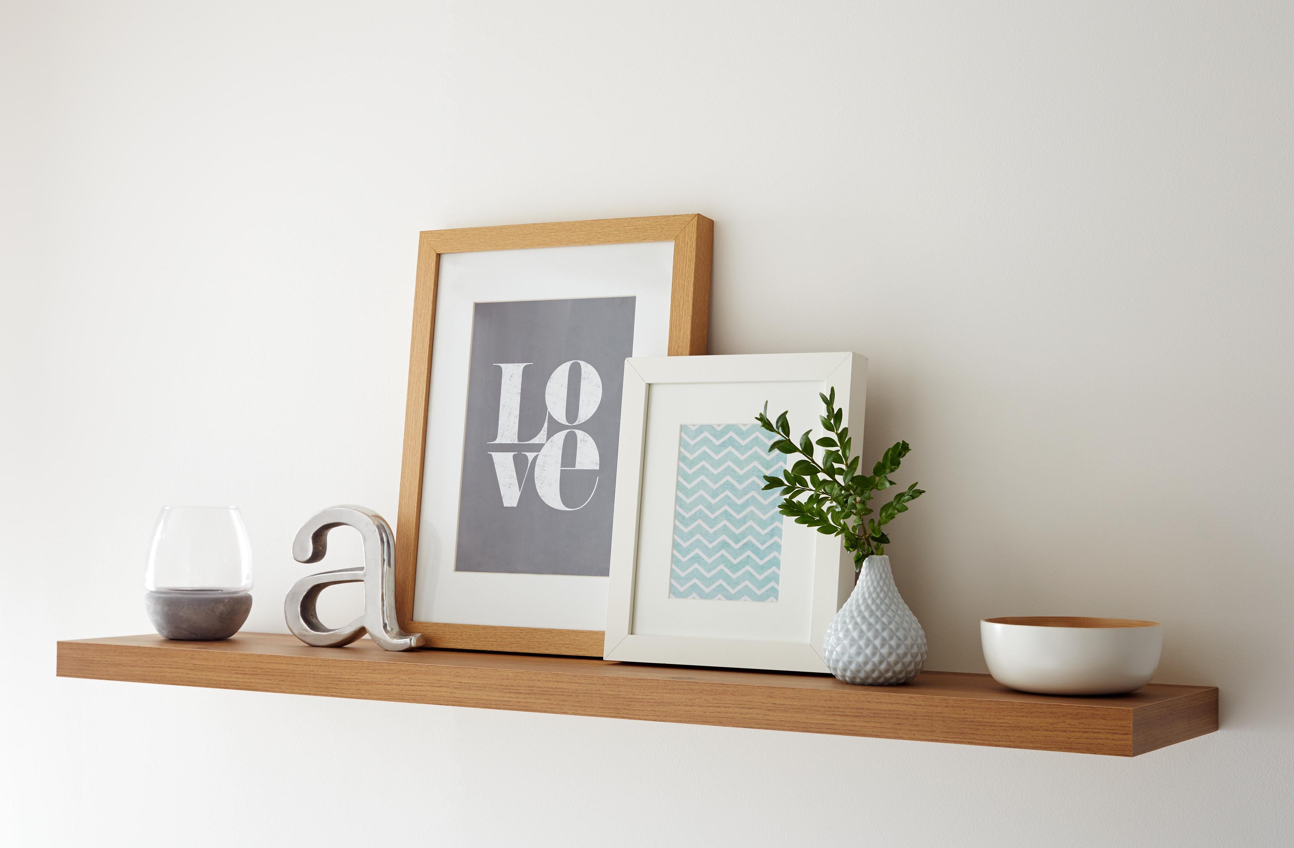 White wall with wooden shelf