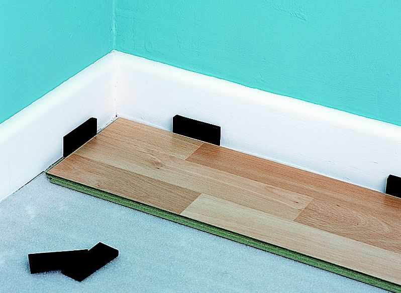 How to lay laminate and real wood top layer flooring Help