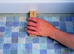 how to cut up flooring to wall edge