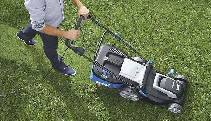 Mowing lawn with Mac Allister lawnmower