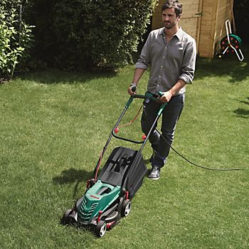 Man mowing lawn with the Bosch Rotak 370 ER Corded Rotary Lawnmower