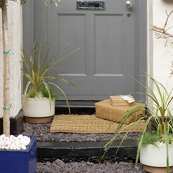 Door step with mat and plants