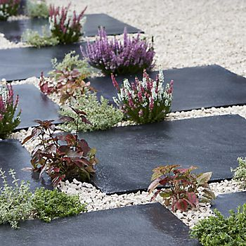 Slate effect paving stones with gravel and plants