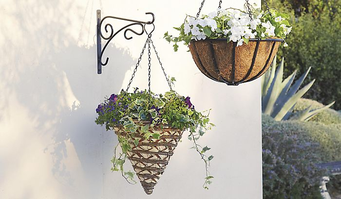 two hanging baskets with flowers""