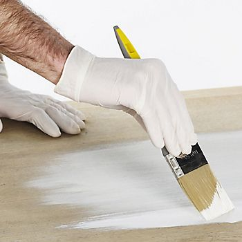 painting with protective gloves on