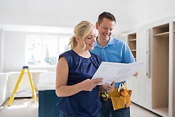 Tradesman advising customer