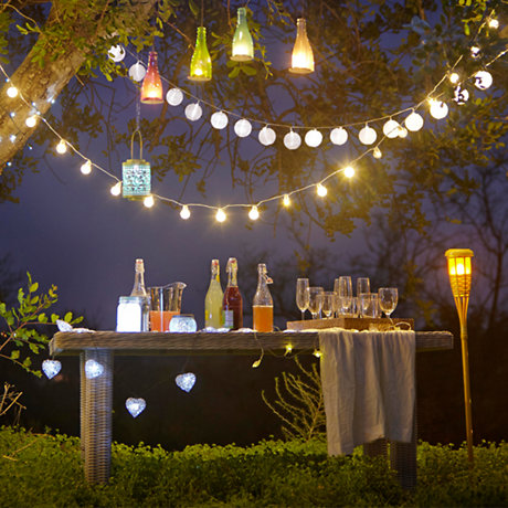 Outdoor lighting with desk lamps and lanterns