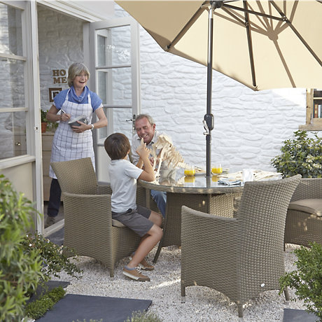 family sat at table in garden