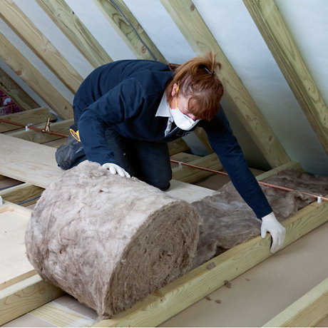 Image of loft insulation being laid. Shop loft insulation