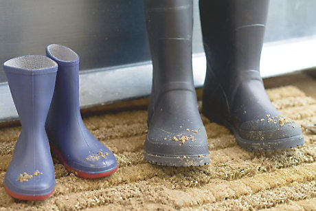 Wellington boots on doormat