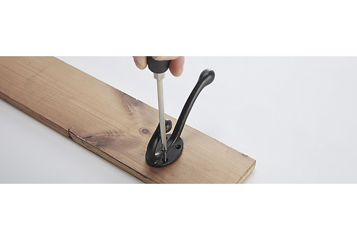 Screwing the hooks into place