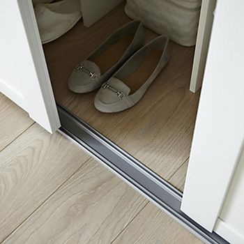 Wardrobe sliding door bottom track