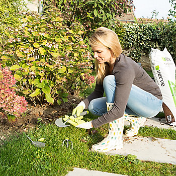 woman in wellies preparing a garden