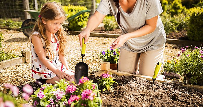 girl and mother planting flowers