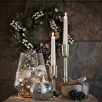 hurricane vase filled with decorations