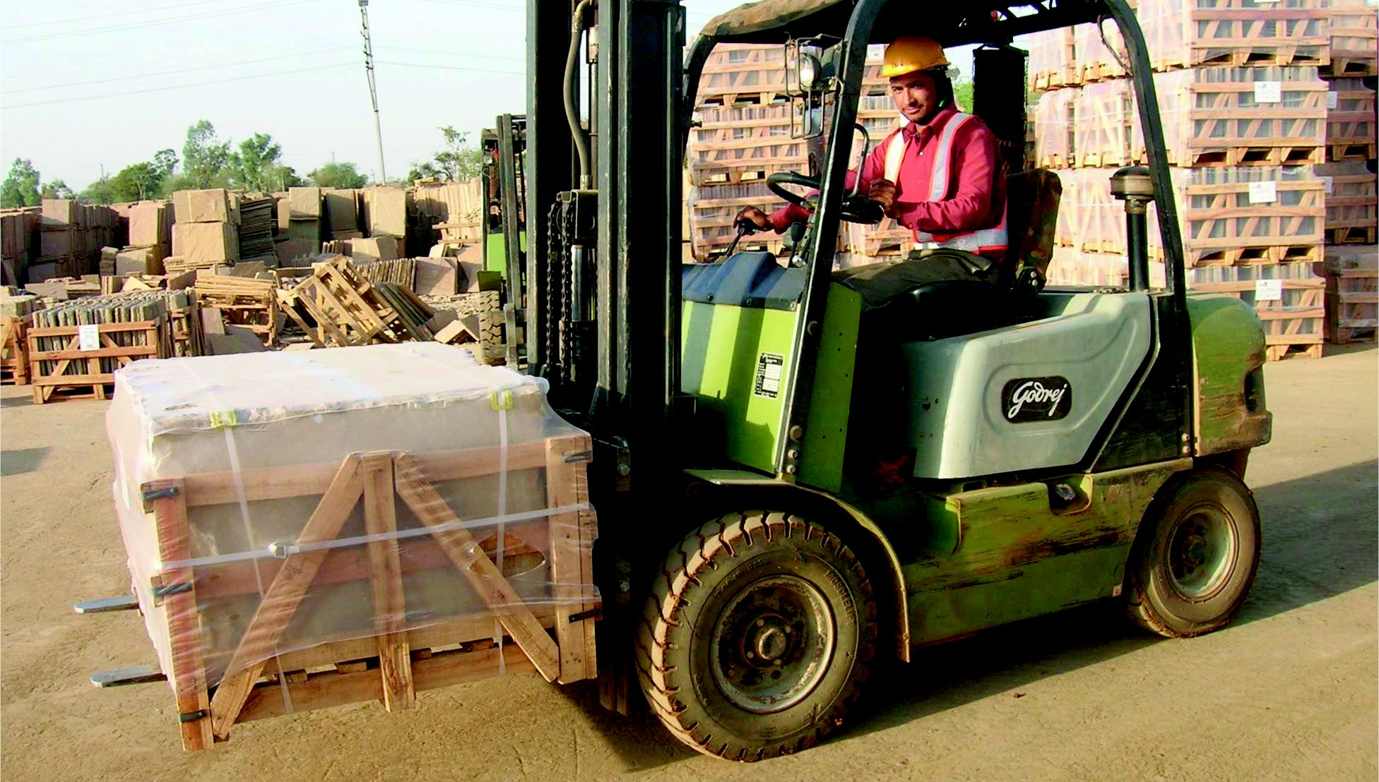 Natural stone paving slabs loaded on a forklift truck