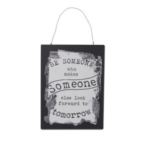 Photo of Black & white printed be someone metal plaque