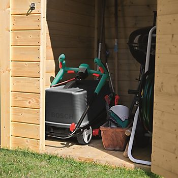 Bosch Rotak 370 ER Rotary Lawnmower stored in wooden garden shed