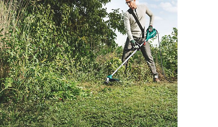 Man using Bosch Afs 23-37 electric brushcutter