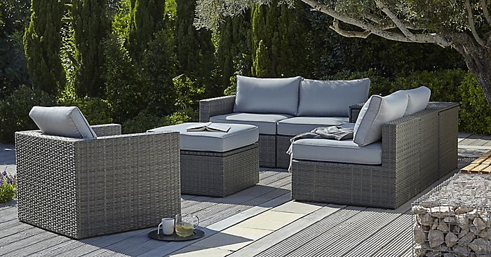 """Sulana Rattan Effect 6 Seater Sofa Set on garden decking in a large garden"""